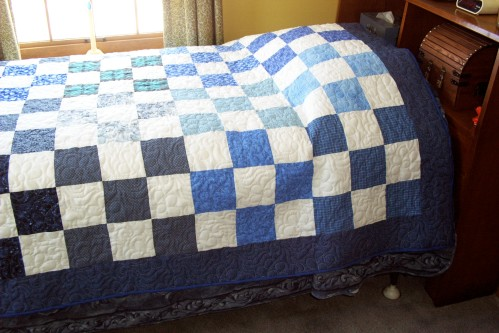 Here's a picture of her simple quilt.